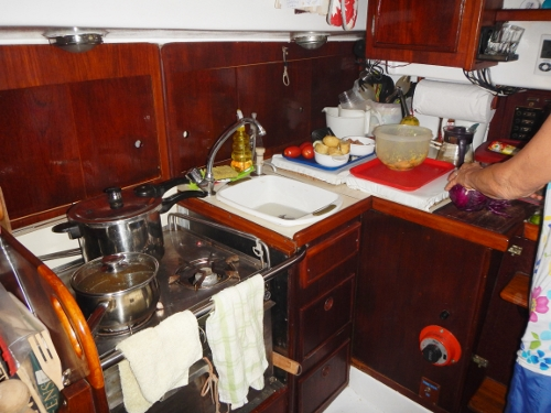 Down below Tundra looking aft to starboard at the galley         and repositioned sink by the stove